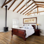 bedroom with exposed timber trusses